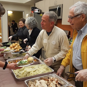 Serving Thanksgiving dinner to Contra Costa Interfaith Housing reesidents (cropped)